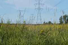 Prairie Power. Photo of electrical transmission towers and lines spanning prairie royalty free stock photography
