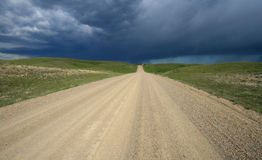 Prairie Road with Dark Sky. Chimney Coulee Road near Eastend, Saskatchewan, Canada royalty free stock photos