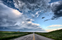 Prairie Road and School House Stock Photography
