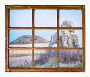 Prairie with rocks and butte window view Stock Photography