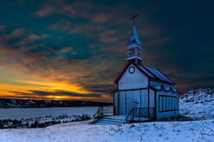 Prairie Rural Church at Winter Sunset. This small town church sits on top of the valley with the sun setting in the background Royalty Free Stock Photos