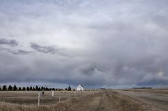 Prairie Storm Clouds Granary. Prairie Storm Clouds in Saskatchewan Canada Rainbow royalty free stock photography