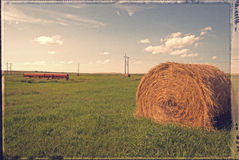 Prairies - vintage. Bale of hay in a wheat field, with a vintage effect and border Stock Photo