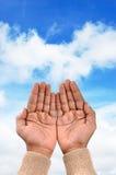 Praise. Man hands  praise against heaven Royalty Free Stock Photos