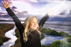 Praise. A little girl stretching her arms out in praise on the beach Royalty Free Stock Photos