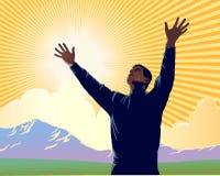 Praise. Man with arms extended toward heaven expressing joy, gratitude and worship Stock Photo