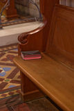 Praise. A Church Pew with a Hymnal on it Stock Photos