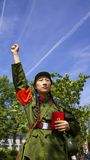 In praise of Chairman Mao. Student dress and a member of Chairman Maos People Republican Army Stock Photography