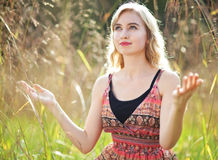 Praise in a field Stock Images