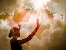 Praise The Lord. Girl worshipping god at sunset royalty free stock images