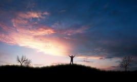 Praising. Man lifting up his arms in praise Royalty Free Stock Image