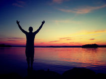Praising nature. A man praising the nature for its gifts Royalty Free Stock Photography