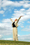 Praising retirement. A happy senior business woman arms stretched out to the sky Stock Photos