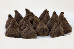 Praline del cioccolato su priorità bassa bianca Immagini Stock