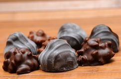 Pralines. On the wood board Royalty Free Stock Photos