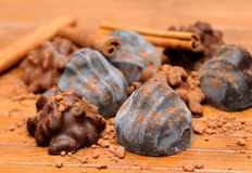 Pralines. On the wood board Royalty Free Stock Photography