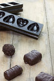 Pralines with chocolate molds on the background Royalty Free Stock Photography