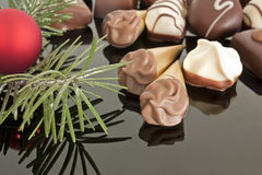 Pralines with pine and bulb. At christmastime Stock Image