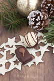 Pralines with pine and cones. At christmastime Royalty Free Stock Image