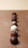 Pralines in a row Royalty Free Stock Photo