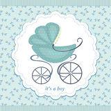 Pram on an abstract background in child blue flowers. Royalty Free Stock Photo
