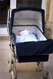Pram with baby. Infant sleeping peaceful in stroller, outdoor Stock Photography