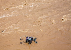 Pram, baby carriage in muddy water. After flood in Chile Royalty Free Stock Photo
