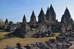 Prambanan Temples with stone ruins seen scattered outside the complex Royalty Free Stock Images