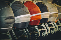 Prams strollers carriages for babies. With vintage colors Stock Photography