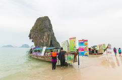PRANANG BEACH, CRABI PROVINCE, THAILAND - MAY 04, 2016: Traditional thai long tail boats with food and drinks for tourists on stock images