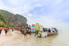 PRANANG BEACH, CRABI PROVINCE, THAILAND - MAY 04, 2016: Traditional thai long tail boats with food and drinks for tourists on stock photography