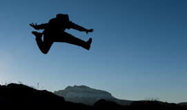 Prance and jump. Enthusiastic & dynamic action silhouette. crazy mountaineer and dynamic man stock images
