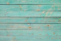 Pranchas de madeira velhas com pintura azul rachada imagem de stock royalty free