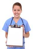 Prancheta bonita da terra arrendada da enfermeira fotografia de stock