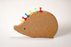 Prancheta na forma de um ouriço com botões coloridos fotos de stock royalty free
