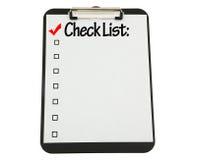 A prancheta preta com lista de verificação anexou Fotos de Stock Royalty Free