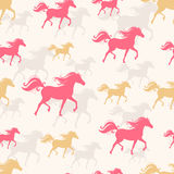 Prancing horses. New Year seamless background with pink and orange prancing horses. The symbol of the new year 2014 Stock Photo