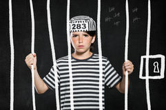 Prank boy in jail Stock Photo
