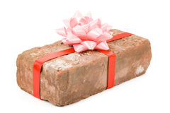 Prank gift. Red Brick Gift, Concept of joke, make fun of somebody, gift on April Fool's Day, Prank gift Stock Photography