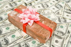 Prank gift and dollars Stock Photo