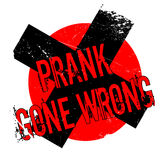 Prank Gone Wrong rubber stamp. Grunge design with dust scratches. Effects can be easily removed for a clean, crisp look. Color is easily changed Stock Photography