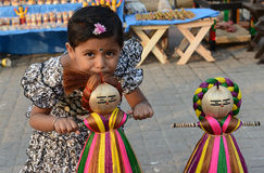 Prank. A little girl prank with jute made toy in the handicraft fair in Kolkata - this is the biggest handicrafts fair in Asia Stock Photos