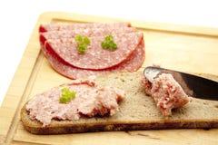 Prank sausage. Coarse mead sausage on bread Royalty Free Stock Photos