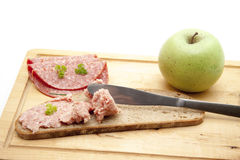 Prank sausage with apple Royalty Free Stock Photo