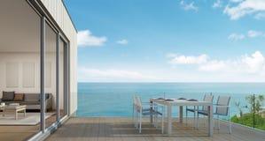 Pranzare all'aperto, casa di spiaggia con la vista del mare nella progettazione moderna Immagine Stock Libera da Diritti
