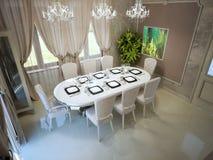 Pranzare elegante con la grande tavola servita Immagini Stock