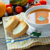 Pranzo con la minestra della zucca Fotografia Stock Libera da Diritti