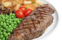 Pranzo della bistecca di lombata Fotografie Stock Libere da Diritti