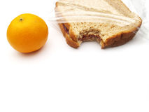 Pranzo - panino ed arancio Immagini Stock Libere da Diritti