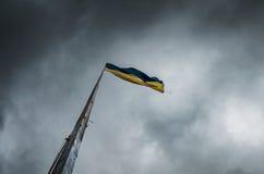 Prapor Ukraine. On a flagpole against the sky,before the rain royalty free stock photos